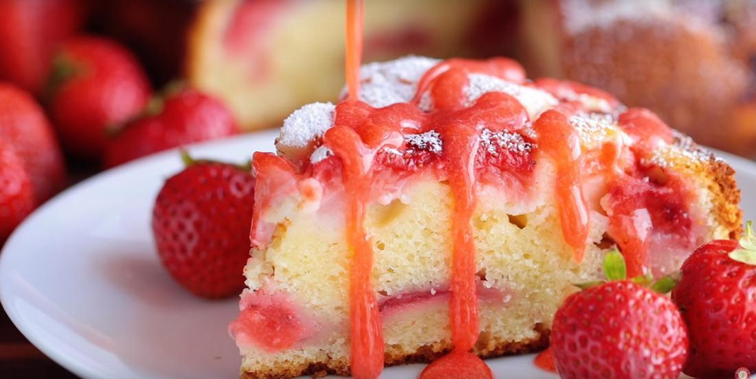Delicious strawberry and sour cream cake topped with a creamy stawberry sauce