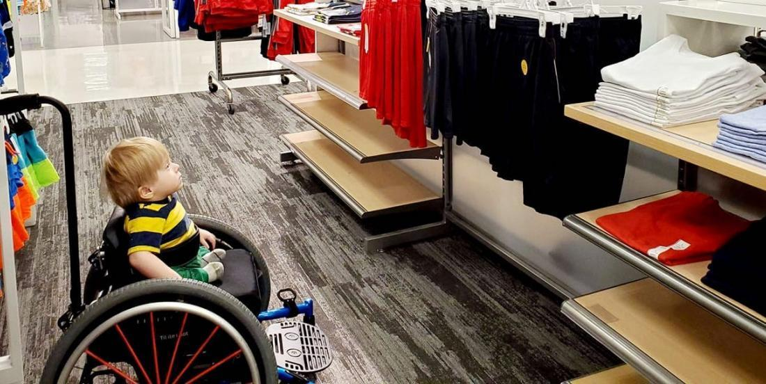 A little two-year old boy was in awe of an ad featuring another boy in a wheelchair at Target!